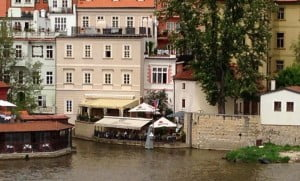 Restaurant in Prague on the riverbank showing the tree on the higher ground of the neighbouring property.