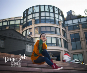Girl sitting on steps outside a large glass building, dreaming of her next career move.