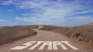 Winding road through a desert with the word START in the foreground.