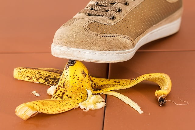Training shoe about to step on a banana skin