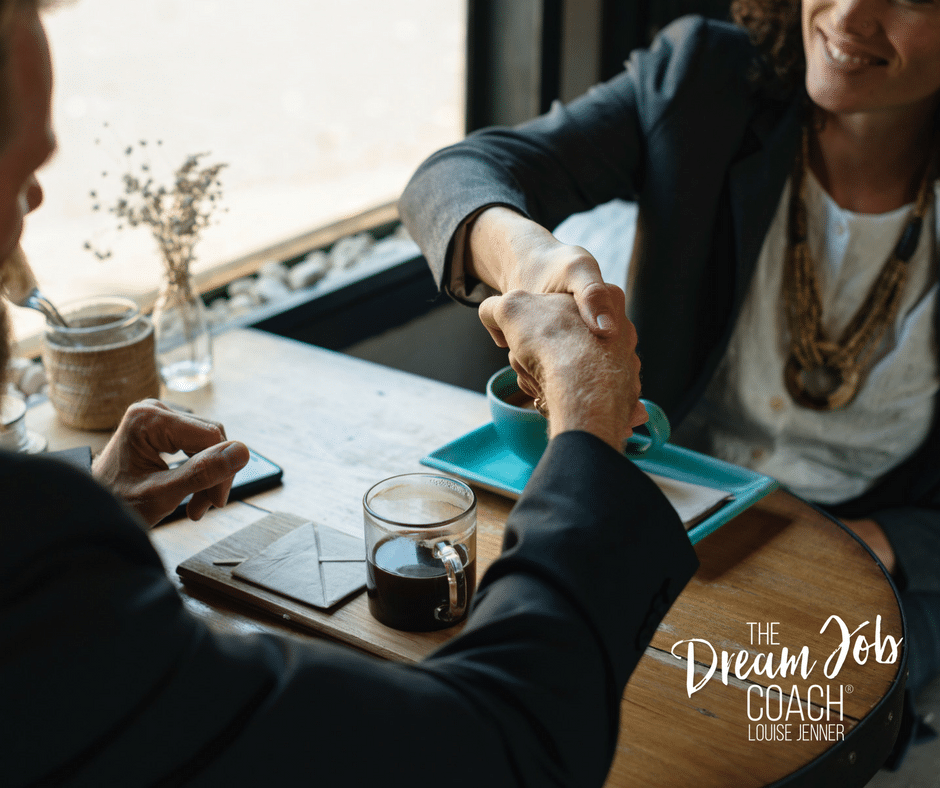Man and woman shaking hands across a table with coffee cups - Louise Jenner, The Dream Job Coach - Career Coaching - Devon